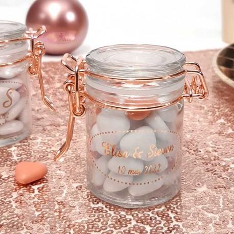 Un contenant à dragées rose gold original en verre pour mariage